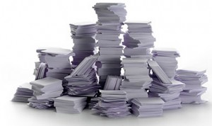 paper piles 300x178 Counter Productive Compassion